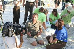 tv-film-crew-shooting-a-documentary-report-on-the-beach_w725_h483.jpg